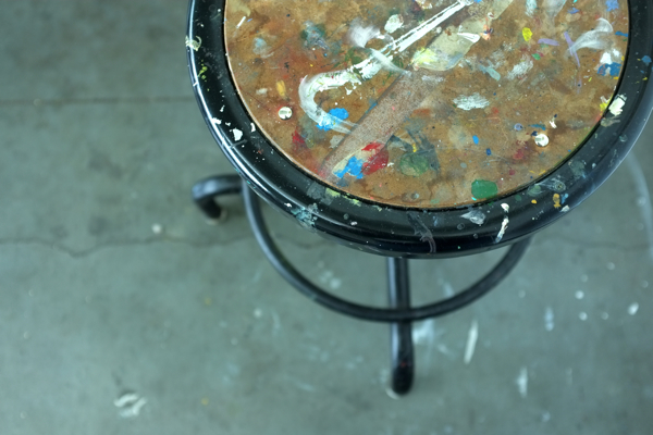 paint spattered stool